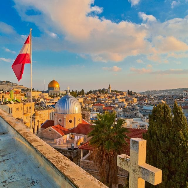 Panoramic view on old part of Jerusalem from roof of Austrian Hospice, Israel. Inscription on pedestal of cross